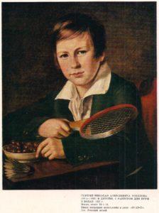 Chłopiec z rakietką do badmintona
